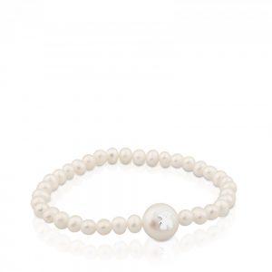 b6bab0d73e56 Pulsera Sweet Dolls de Plata. Esta pulserade perlas rosas cultivadas en  auga dulce tiene en el centro una bola de mayor tamaño con el oso de Tous  en plata.